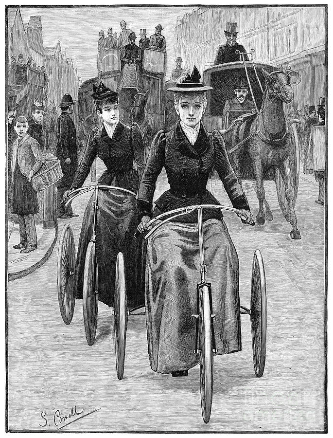 Women bicycling in 1892, successfully using technology in a horse-and-buggy filled street.